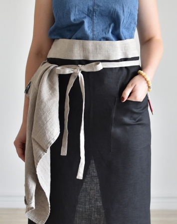 Black linen half apron with a pocket