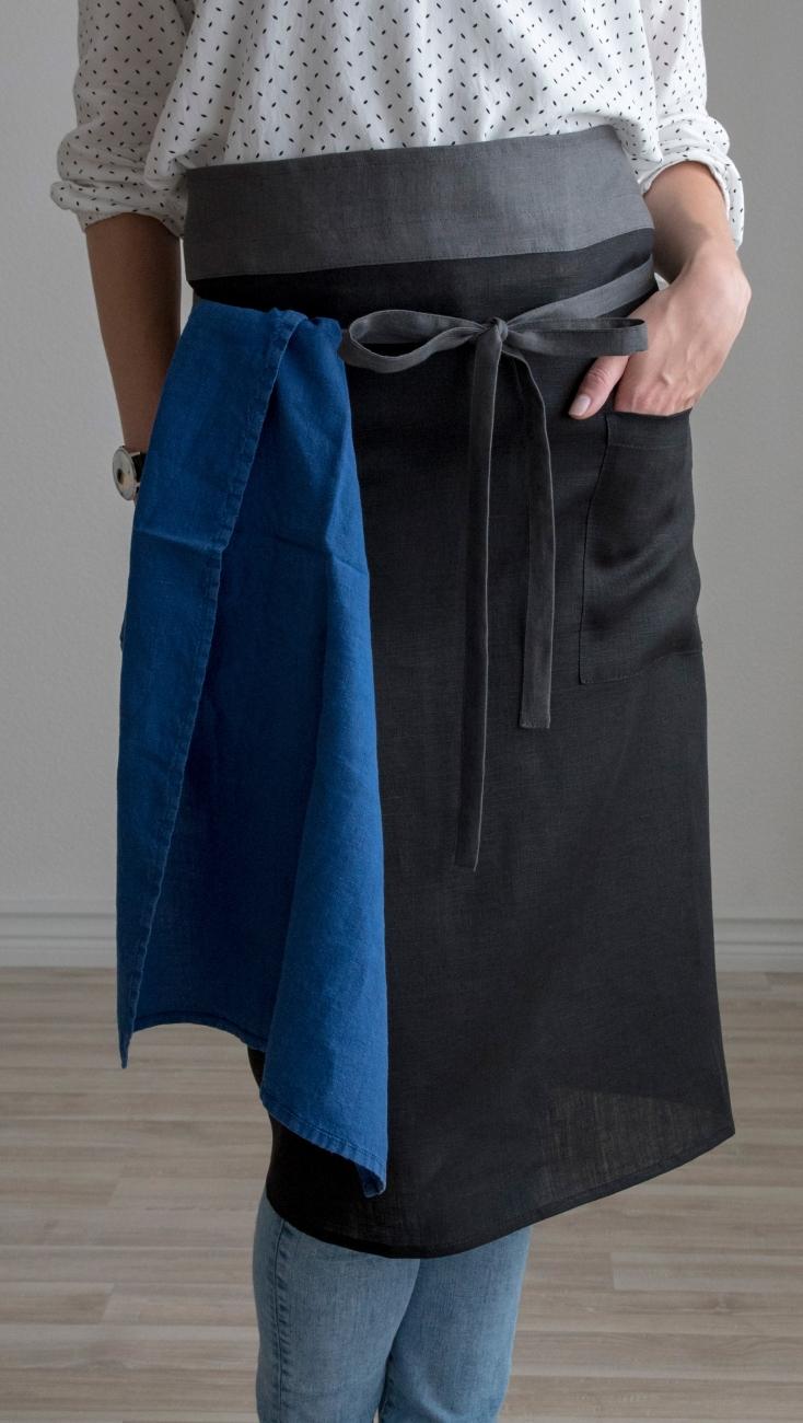 Black linen half apron with a pocket