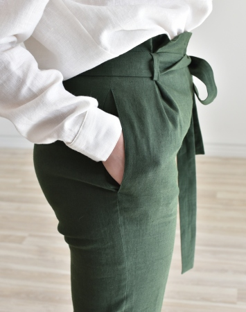 Dark green fitted linen pants with paper bag waist