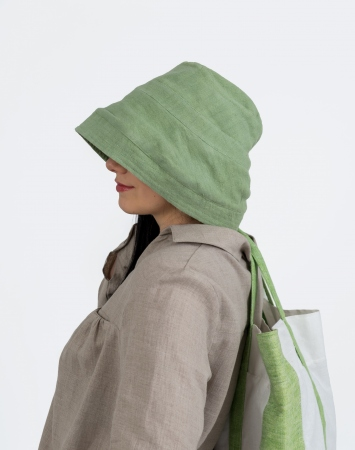 Green bucket hat with stitching