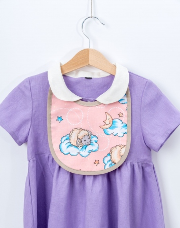 Light pink cotton bib with sheep print