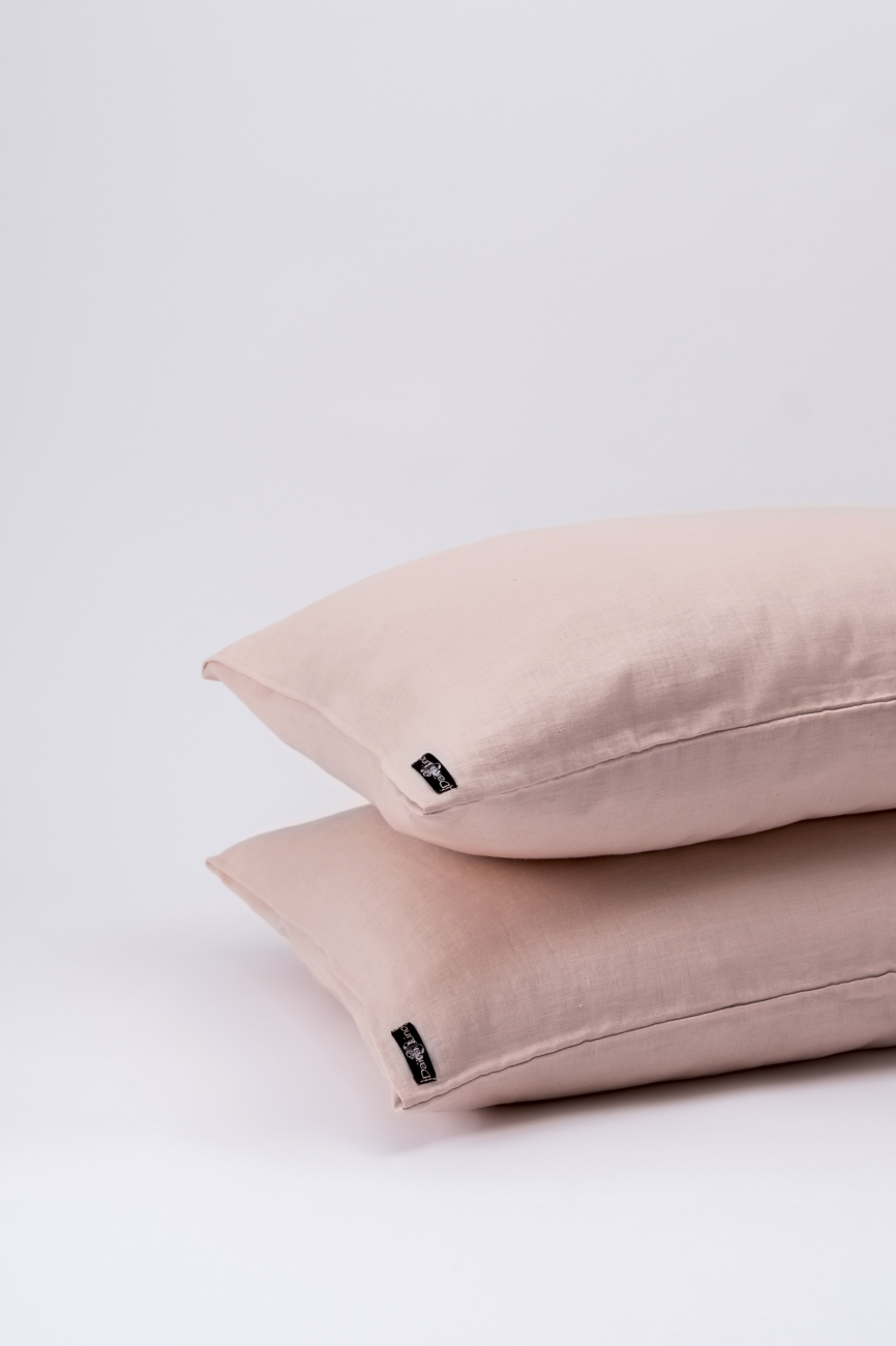 Light pink washed linen pillowcase with an envelope closure