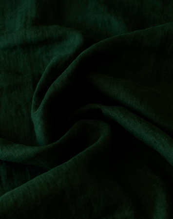 Lightweight linen fabric in deep green color