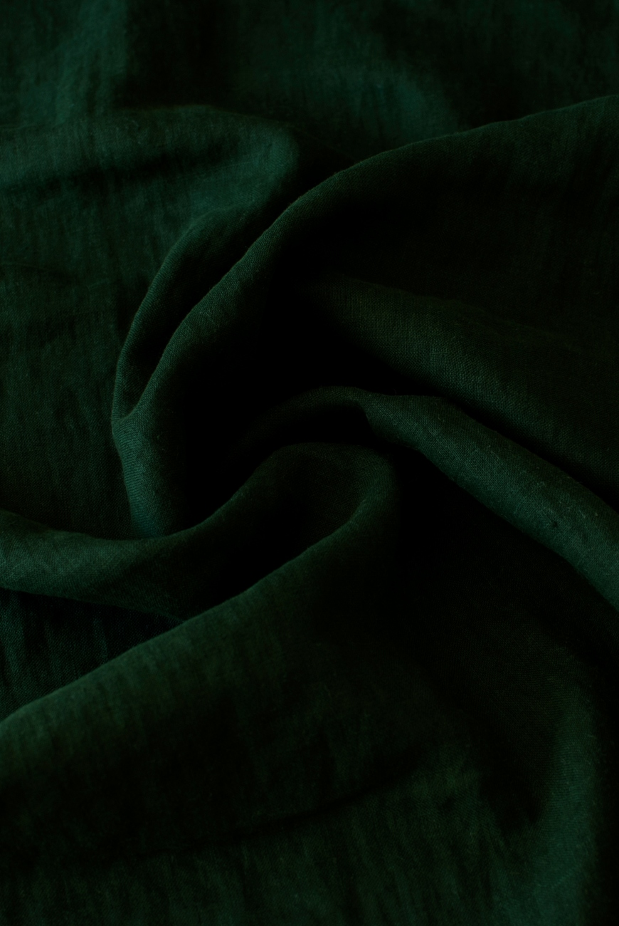 Lightweight linen fabric in deep green color