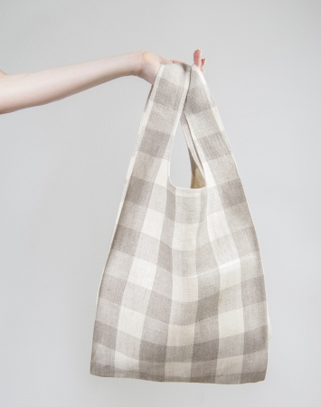 Linen knot bag with buffalo check pattern