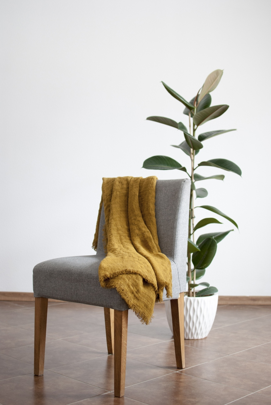 Mustard linen throw blanket with frayed ends