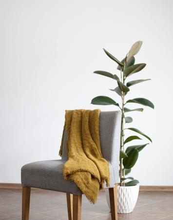 Mustard linen throw blanket with simple hem