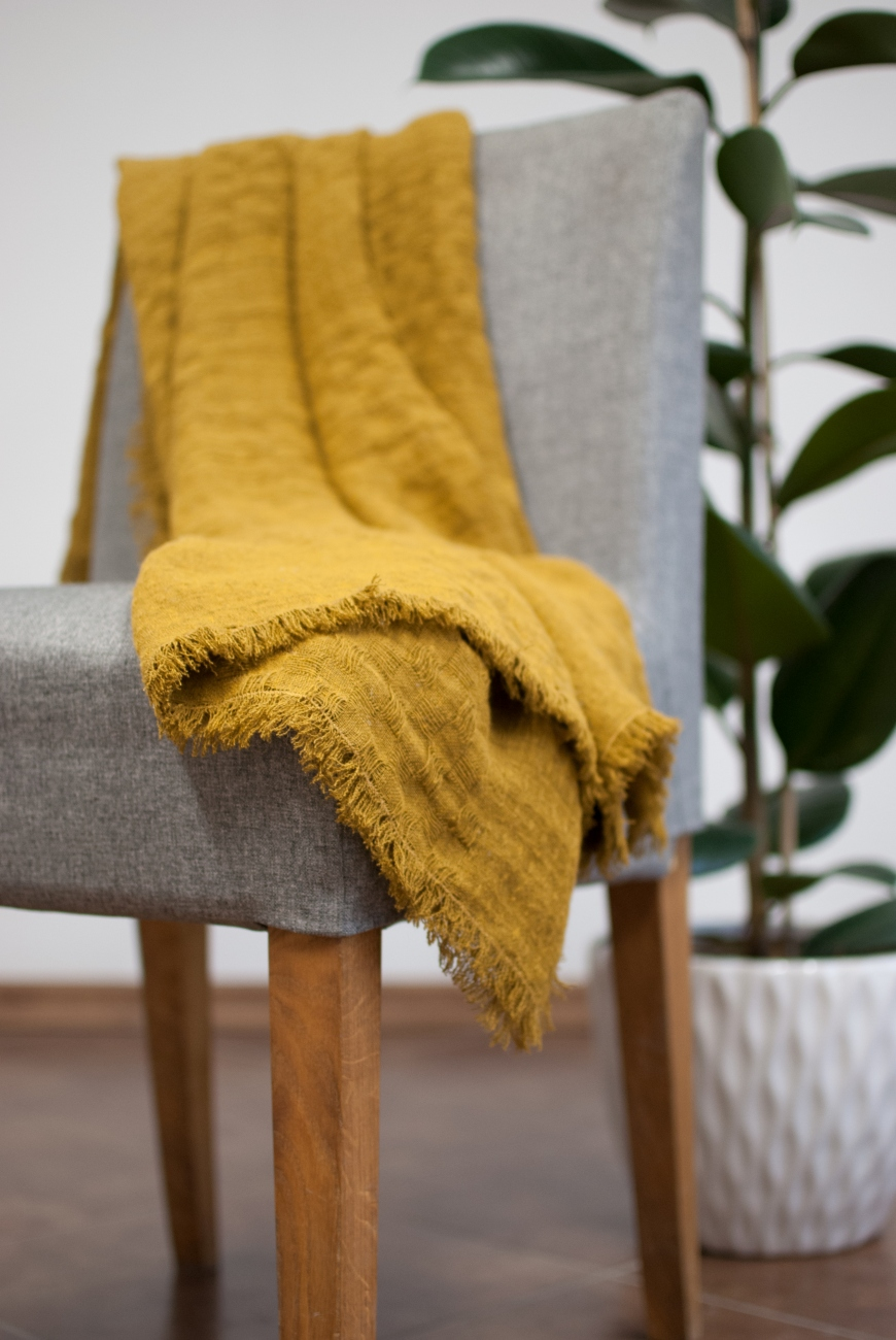 Mustard linen throw blanket with simple hem