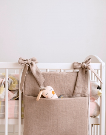 Natural linen nursery crib organizer