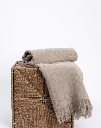 Natural linen throw blanket with frayed ends