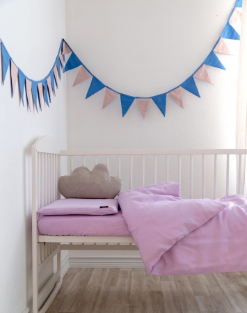 Pink three-piece baby bedding set