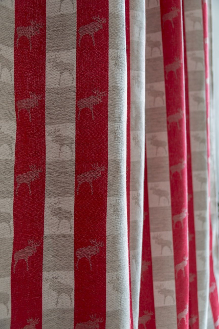 Red tab top curtain panel with moose pattern