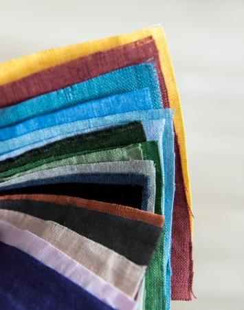 Sample of an artichoke green 180 gsm linen fabric