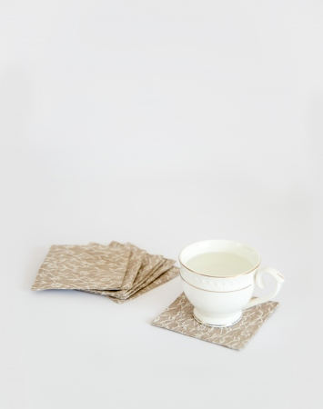 Set of 6 linen coasters with white embroidered pattern