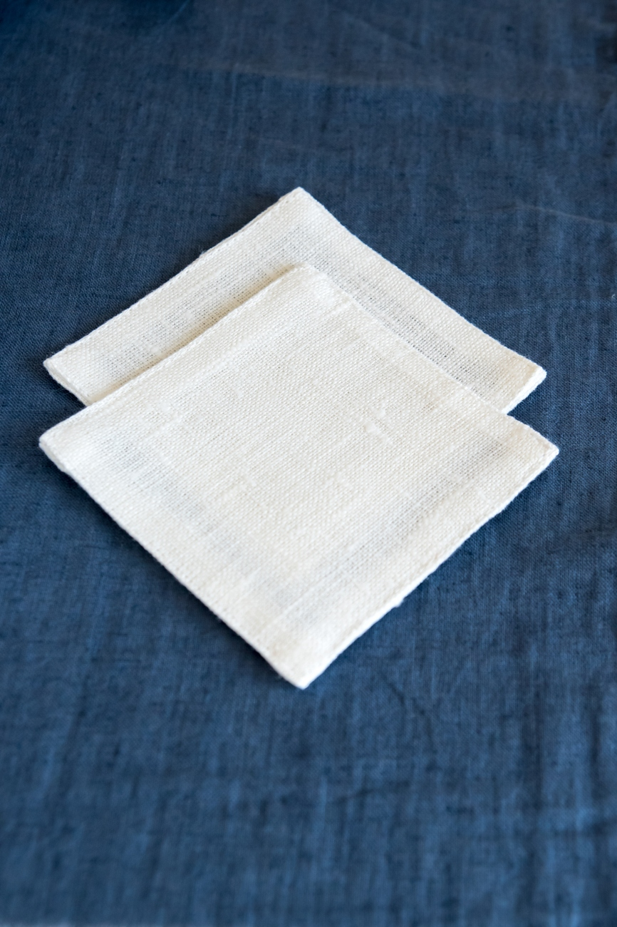 Set of 6 off-white linen coasters