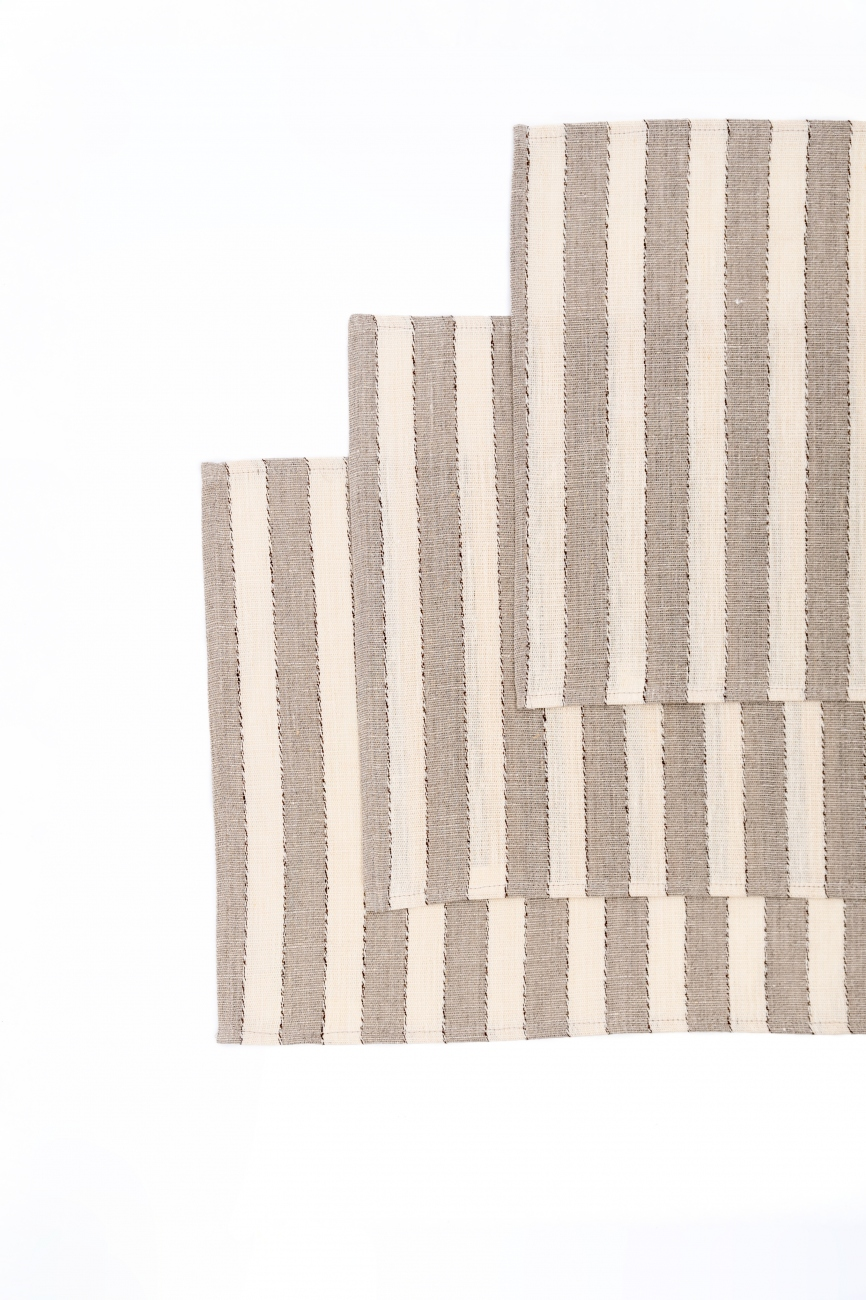 Set of beige linen table placemats with narrow stripes