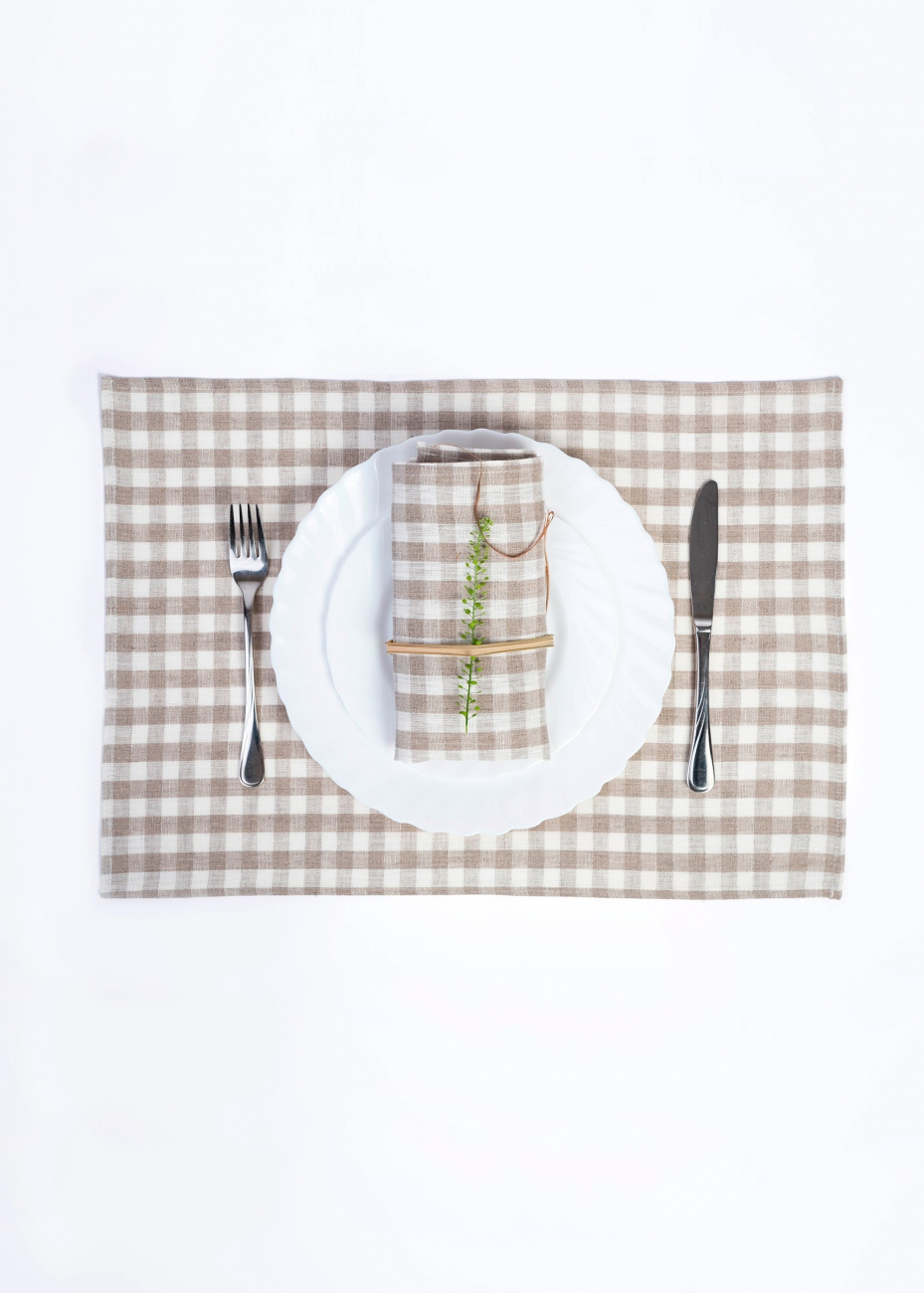 Set of linen table placemats with natural checks