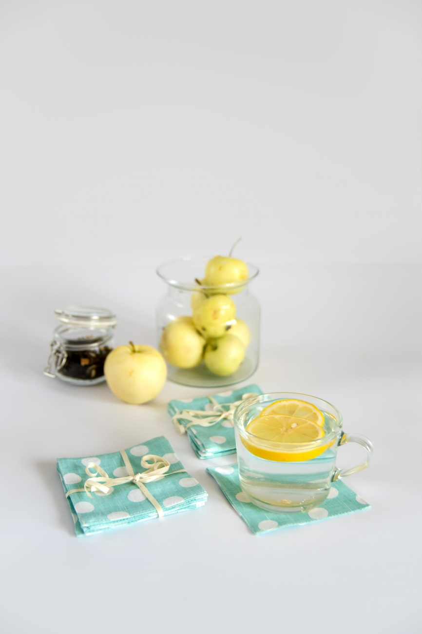 Set of mint linen coasters with polka dot pattern