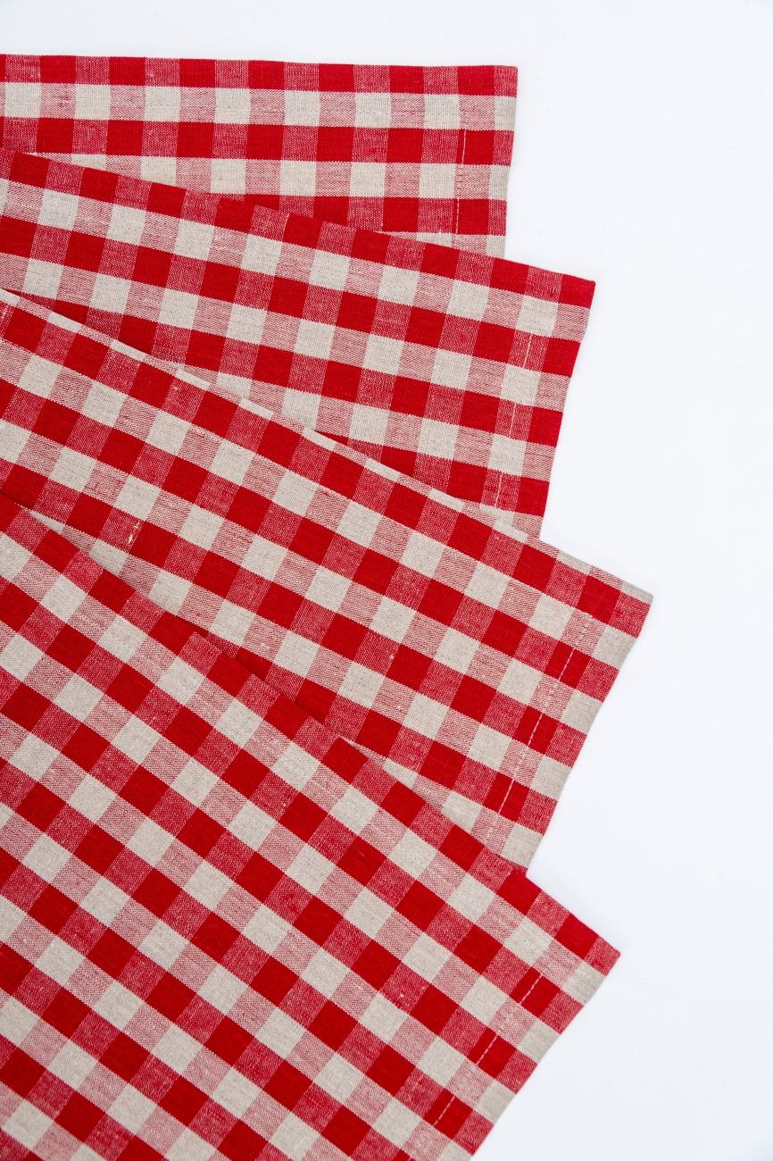 Set of red linen table placemats with ckecks