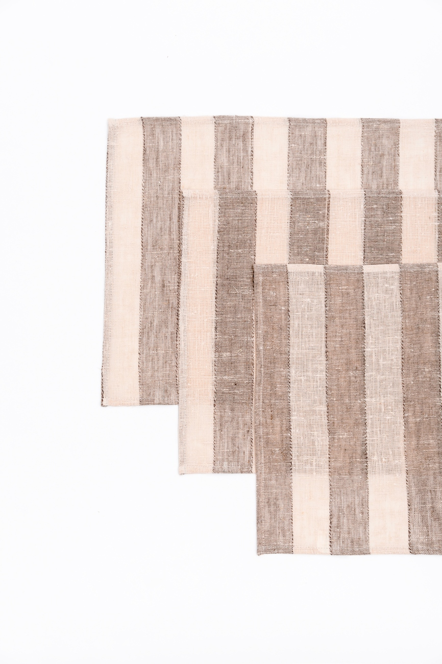 Set of striped linen table placemats in beige