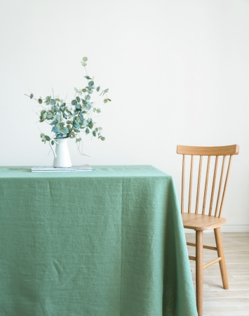 Washed linen tablecloth in basil green