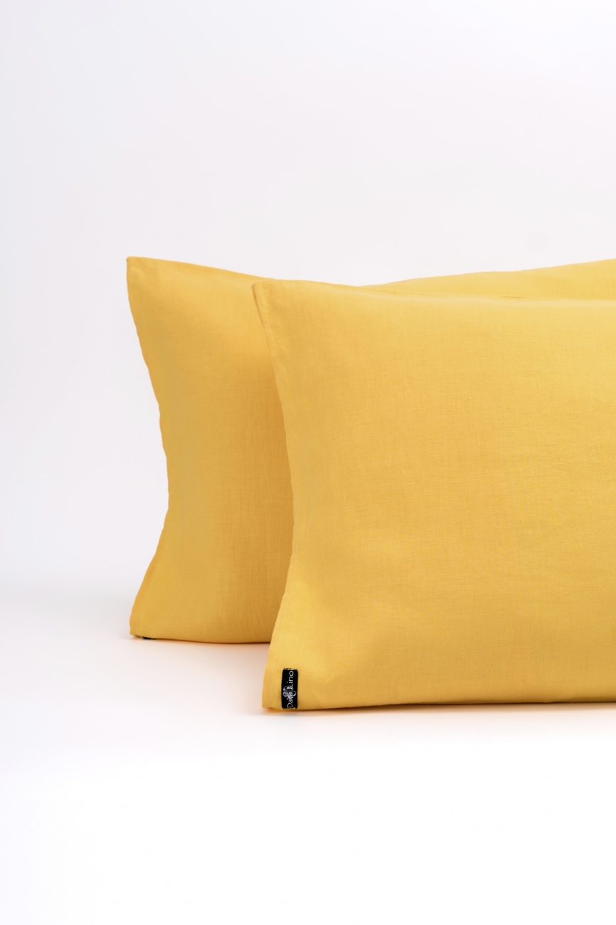 Yellow washed linen pillowcase with an envelope closure